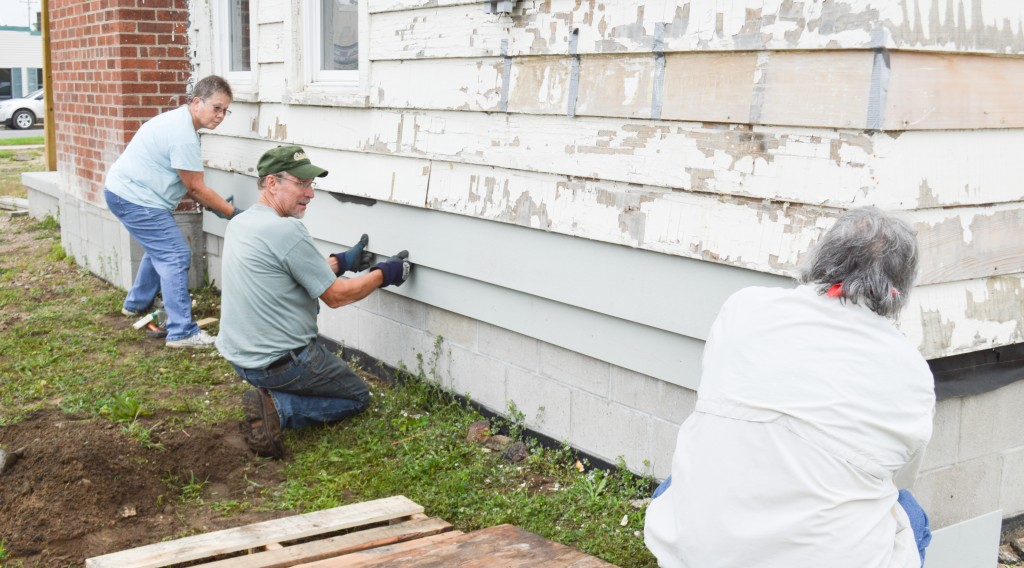Helen Radtke, Bruce Micinski & Tom Curtin installing new exterior siding - Museum Project Volunteers 2015